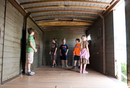 Students exploring boxcar interior