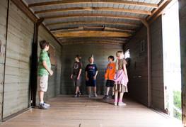 Students exploring boxcar interior