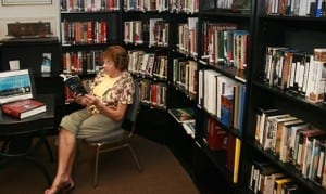 image of woman reading in the holocaust museum library