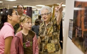 Lorie Mayer speaks with young visitors at the Holocaust Museum & Education Center of Southwest Florida.