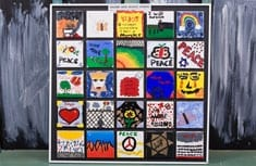 Students created tribute tiles to commemorate Holocaust victims.