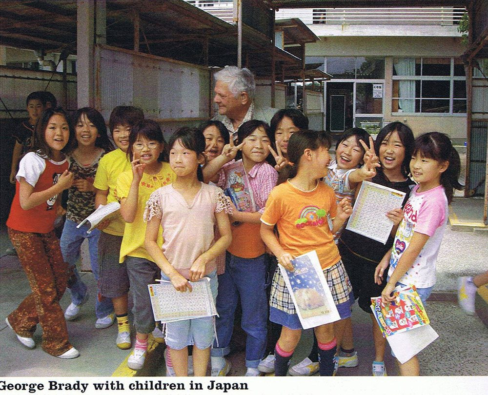George Brady with children in Japan