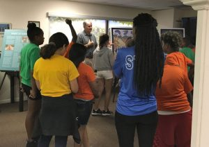 Education Specialist, Sam Parish teaches students from Collier County Boy's and Girl's Club in the Museum.