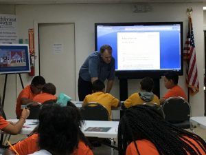 Education Specialist, Sam Parish, guides students in the Museum Classroom.