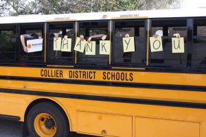 school bus with student hands out the window spelling Thank you to Suncoast