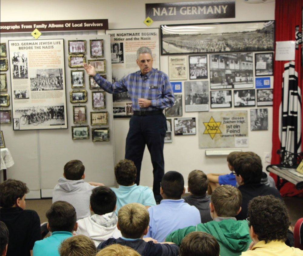 Docent Stuart Mest, son of Survivors, teaches students