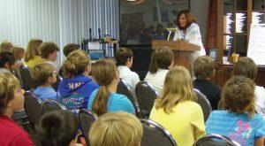 Survivor Sabine van Dam shares with students