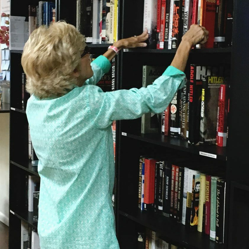 Volunteer-Patti-Bloom-Shelving-books-5-3-17